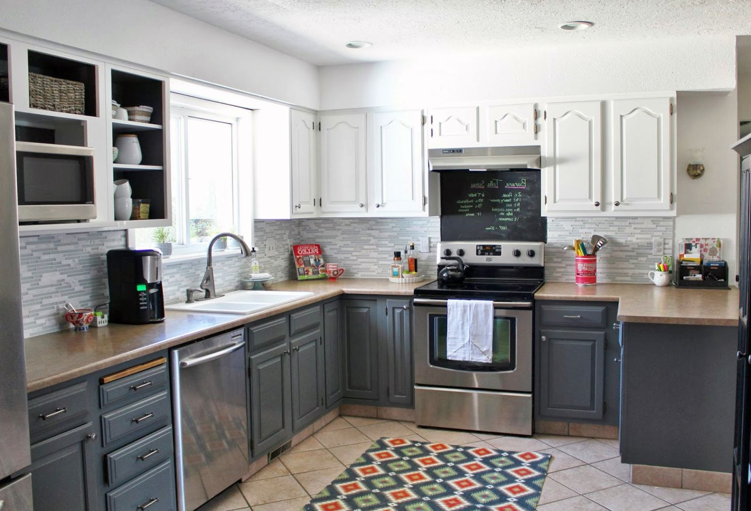 wood kitchen cabinets design with brown granite and black appliances