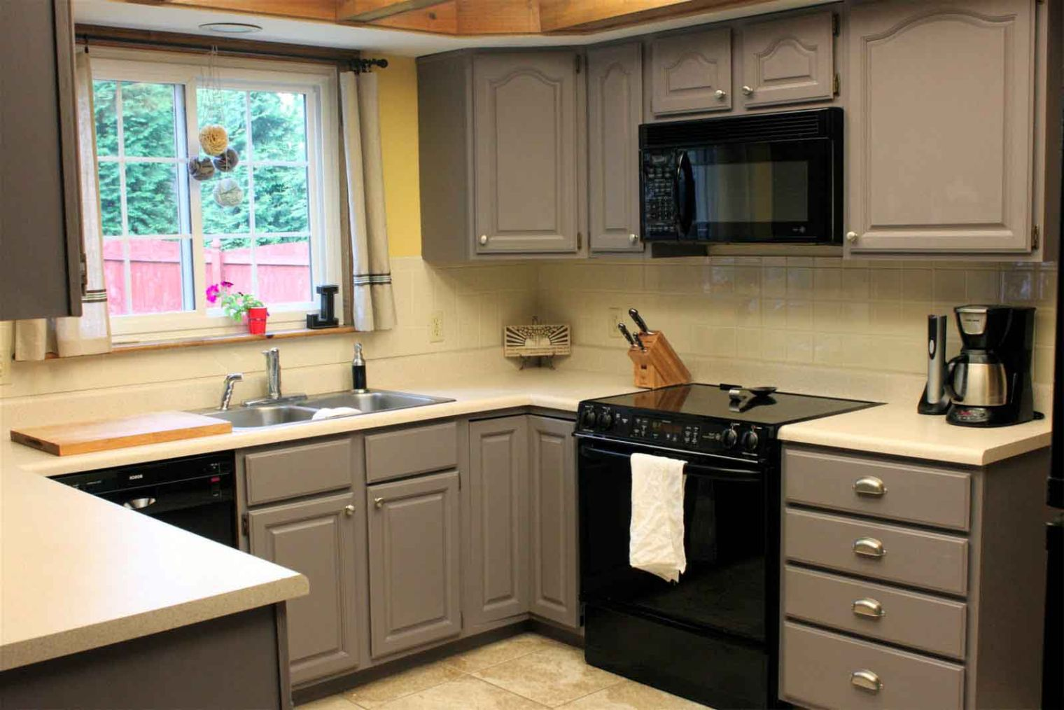 Grey painted kitchen cabinets in small kitchen space for Small upper kitchen cabinets