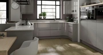 Wonderful grey kitchen inspiration with wooden cabinets and floors