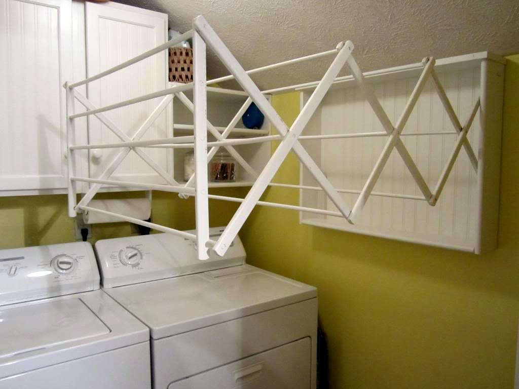 19 laundry room clothes hanger racks design ideas for Clothespin photo hanger