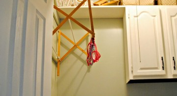 hanging laundry room clothes hanger racks designs for limited space
