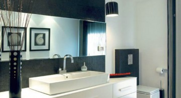 white vanity in stunning modern black and white bathroom interior