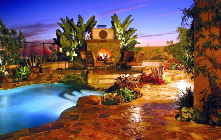 Backyard pool designs with fireplace