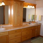 Bathroom vanity lighting ideas with natural colored woods