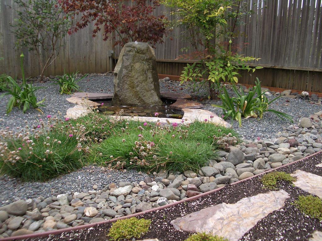 Japanese garden backyard design with big rock