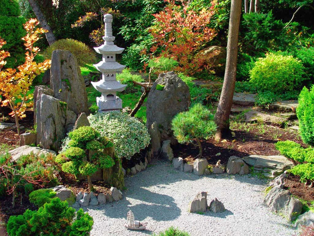 Japanese garden backyard design with stone pagoda for Backyard japanese garden design ideas