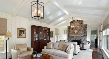 Vaulted ceiling used in large living room with stacked stone fireplace