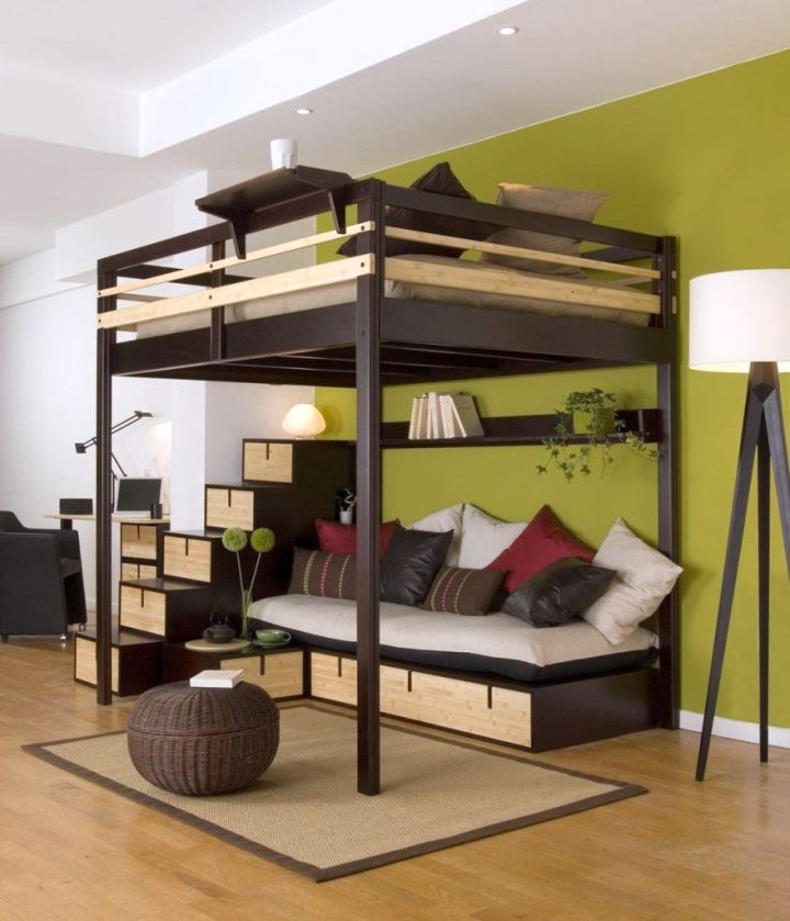 adult loft bed with stairs in dark woods
