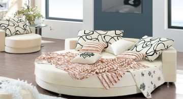 all white circular bed with chic pattern sheets