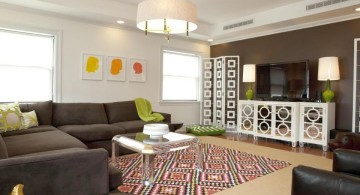 art deco living rooms with geometric print rug and muted grey sofa