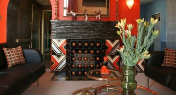 art deco living rooms with red wall and unique tiered glass table