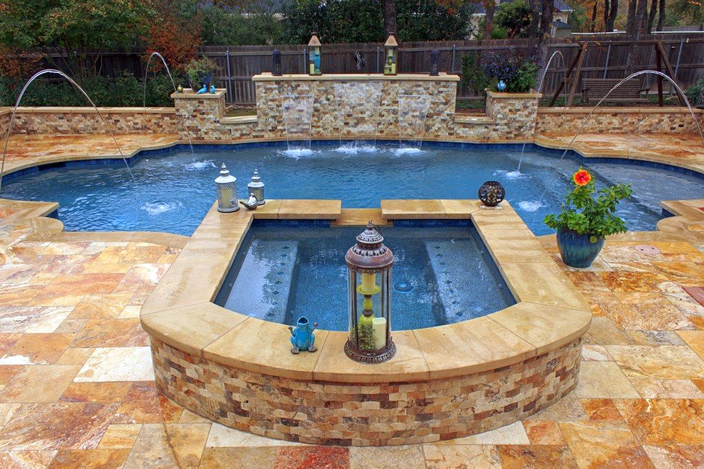 Awesome pool shapes and designs with jacuzzi for Pool design austin