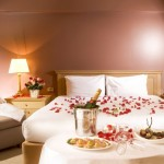 bedroom decoration for valentines day with flowers and champagne