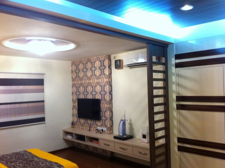 bedroom wall panel design ideas with unique pattern on top of striped walls