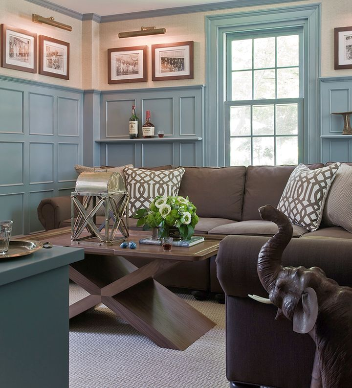 pastel blue wall with muted brown sofa is a sure thing for being
