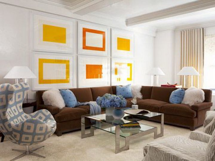 blue and brown living room with acrylic coffee table and yellow wall