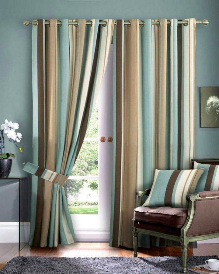 Blue and brown living room with striped curtain
