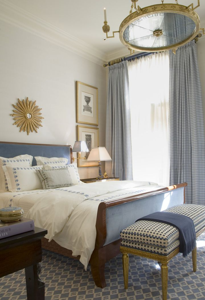 blue and gold bedroom with chandelier for guest bedrooms