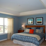 blue and white toned tray ceiling bedroom