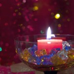 bowl centerpiece ideas with colored crystals and candle