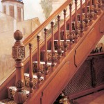 carpeted wooden staircase designs with classic banisters