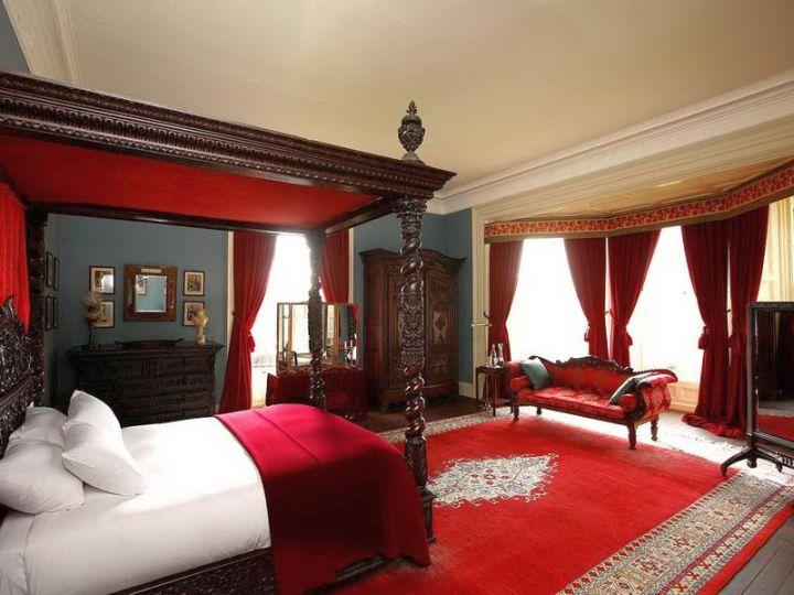 classy red and black bedroom with canopied bed
