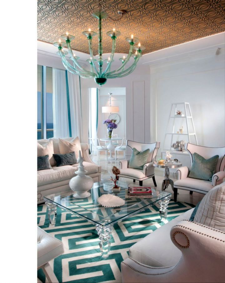 classy turquoise living room with chandelier