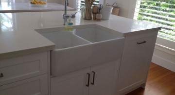 close up on simple kitchen island with sink