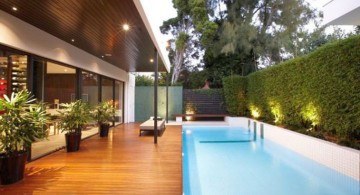 contemporary Backyard pool designs with wooden deck