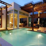 contemporary best backyard swimming pool designs with wood patio