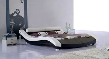curved bed designs in black and white with brown and white linen