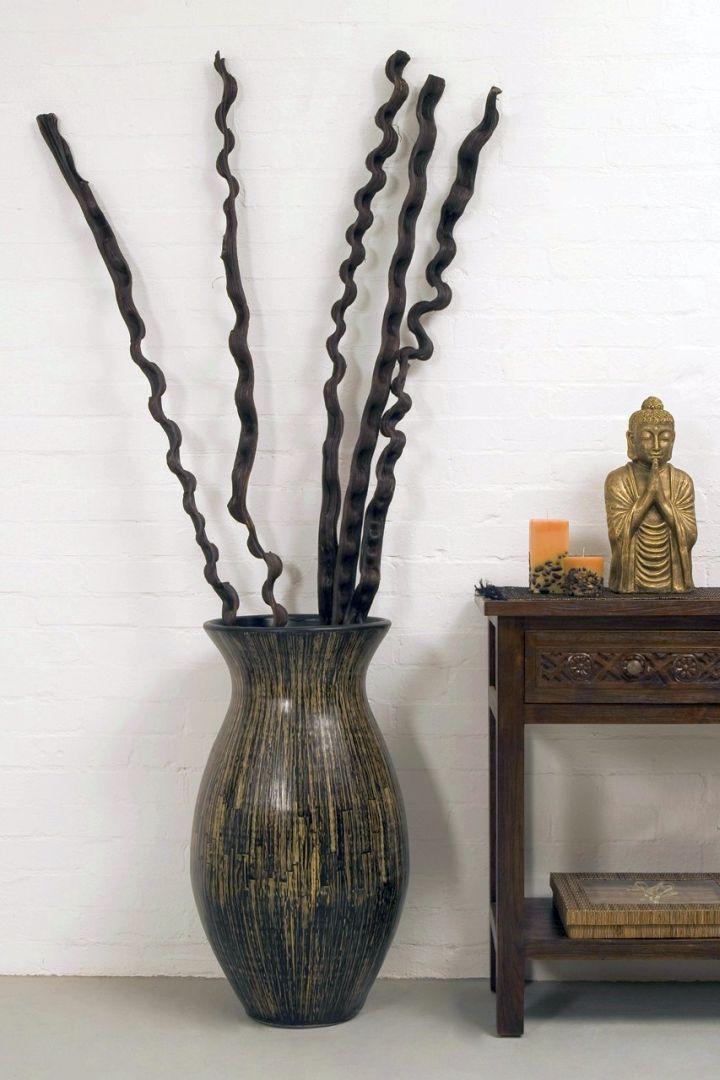 dark floor vase with branches