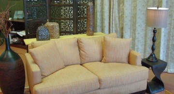 earth tone living room with Asian separator