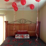 easy DIY bedroom decoration for valentines day with balloons and rose petals