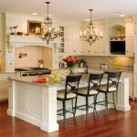 elegant white and marble countertop kitchen island with sink and seating