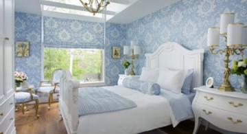 feminine blue and gold bedroom with blue wallpaper