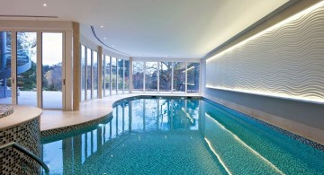free formed indoor swimming pool with glass doors