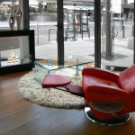 freestanding fireplaces designs with red reclined chair