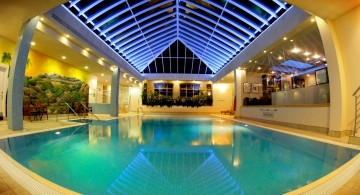 glamorous indoor swimming pool with wide skylight