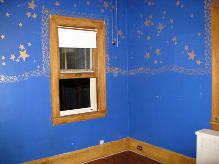 golden stars painting for blue and gold bedroom