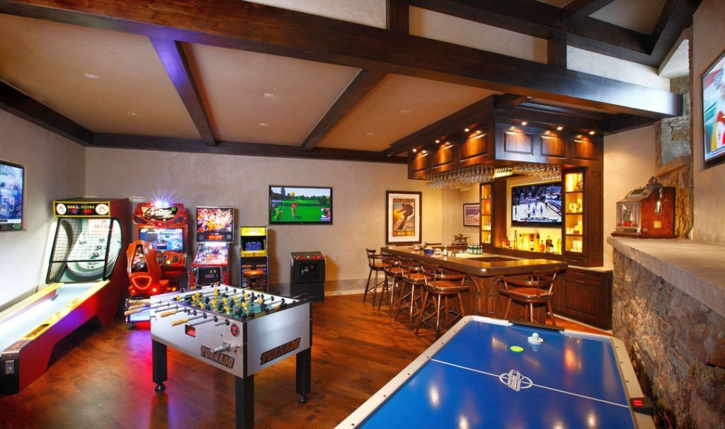 hang out room ideas with lots of games and mini bar