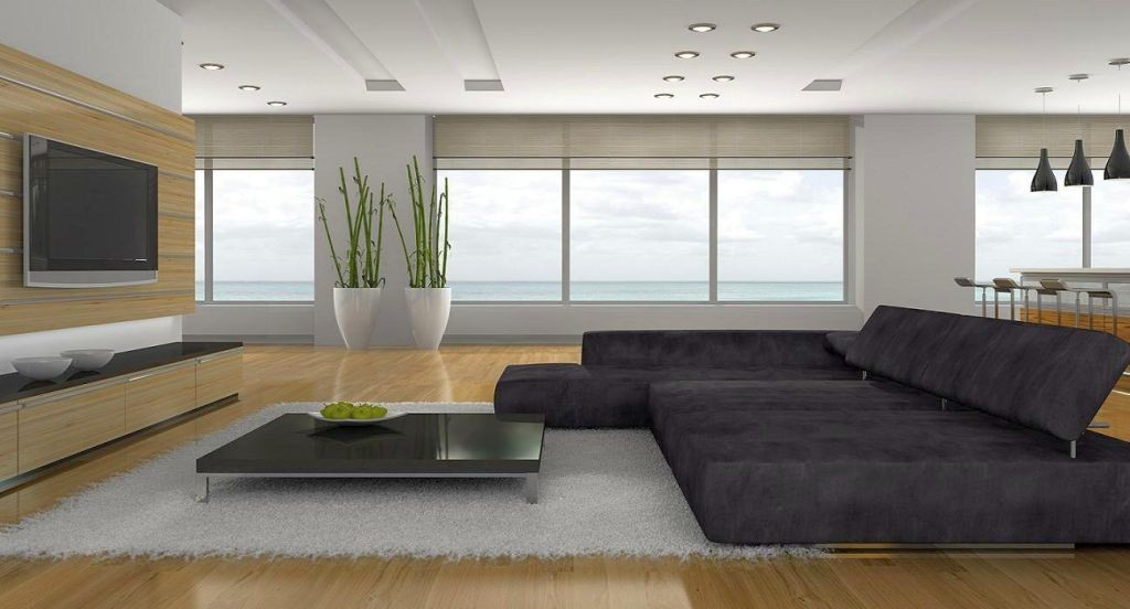 hang out room ideas with wide sofa in monochrome tone and wooden floor
