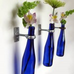 hanging flower vase in cobalt blue bottles