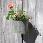 hanging flower vase using old bucket