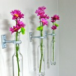 hanging flower vase with old bottles