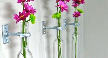 hanging flower vase with old bottles