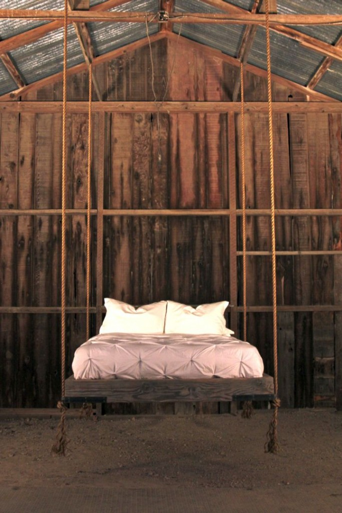 hanging swing bed in a rustic cabin
