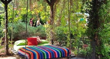 hanging swing bed with colorful bedding