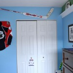 hockey bedrooms with jersey and stick on the wall