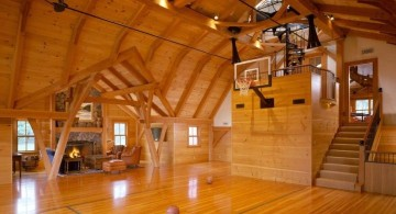 indoor home basketball courts with visible wooden beams